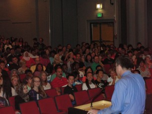 English teacher and freshman class sponsor, Mr. Barth, presides over incoming students at orientation.