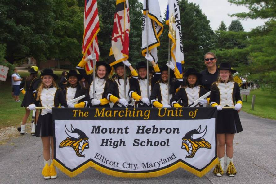 The Cavaliers pose with Mr. Ruehl at the start of last year's Homecoming Parade (Photo courtesy of MTH Band Parents).