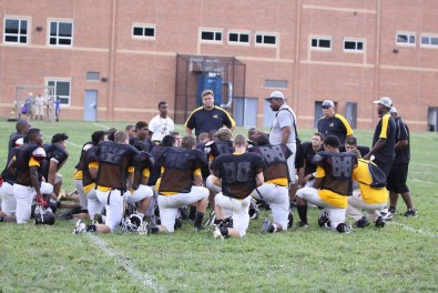 The 2013-2014 varstiy football team huddles up at practice to prepare for the homecoming game (Photo courtesy of Mt. Hebron Football).