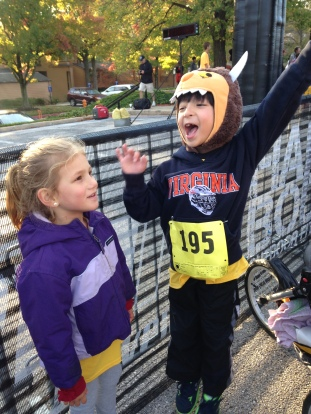 Five-year-old Camila Cornell, daughter of former Mt. Hebron Spanish teacher and current HoCo World Languages Resource teacher Ms. Jennifer Cornell (Left), and six-year-old Wild Thing, Paolo Fulchino, son of English teacher Ms. Rachel Fulchino, celebrate finishing the Fun Run.