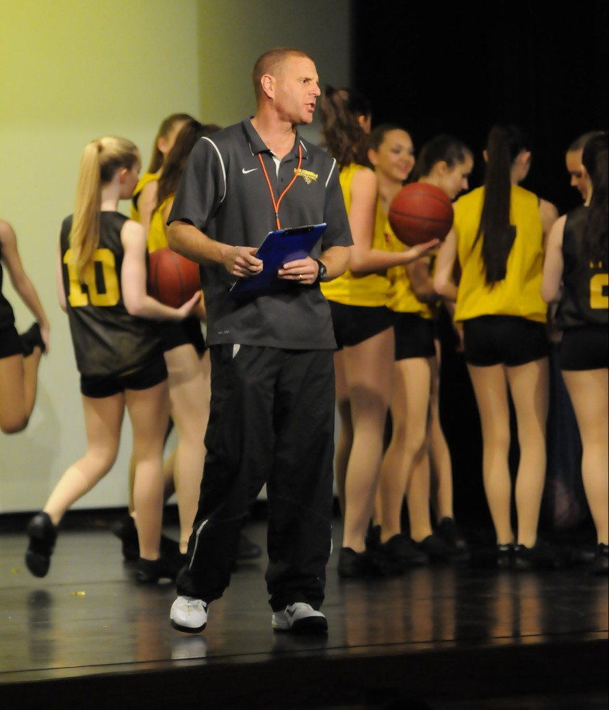 Teacher and basketball coach Mr. Mike Linsenmeyer makes an appearance during the performance.